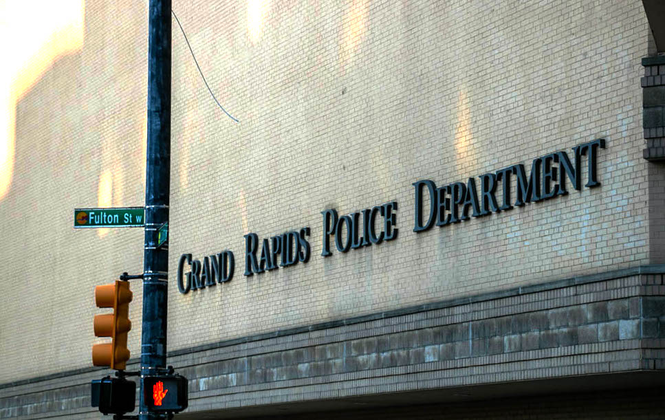 Photograph of the Grand Rapids Police Department at the intersection of Fulton St & Division Ave